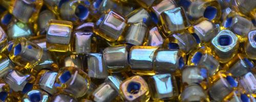 TOHO Cube 2mm (#926) Inside-Color Lt Topaz/Opaque Lavender Lined